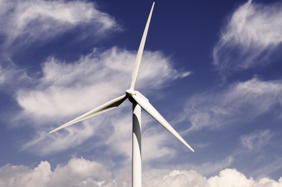 wind turbine renewable energy source in the cloud sky