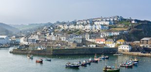 Mevagissey Cornwall - April 12 2018: Mevagissey harbour within the Cornwall Area of Outstanding Natural Beauty the village dates to the medieval period and is a popular destination for tourists