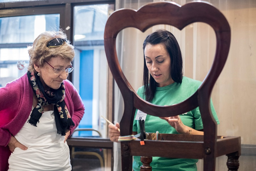 Local resident Nicola Stabb with Kelly Sharp, Furniture Repair Specialist, NLWA Repair Cafe, Queen's Crescent Community Centre, Camden.