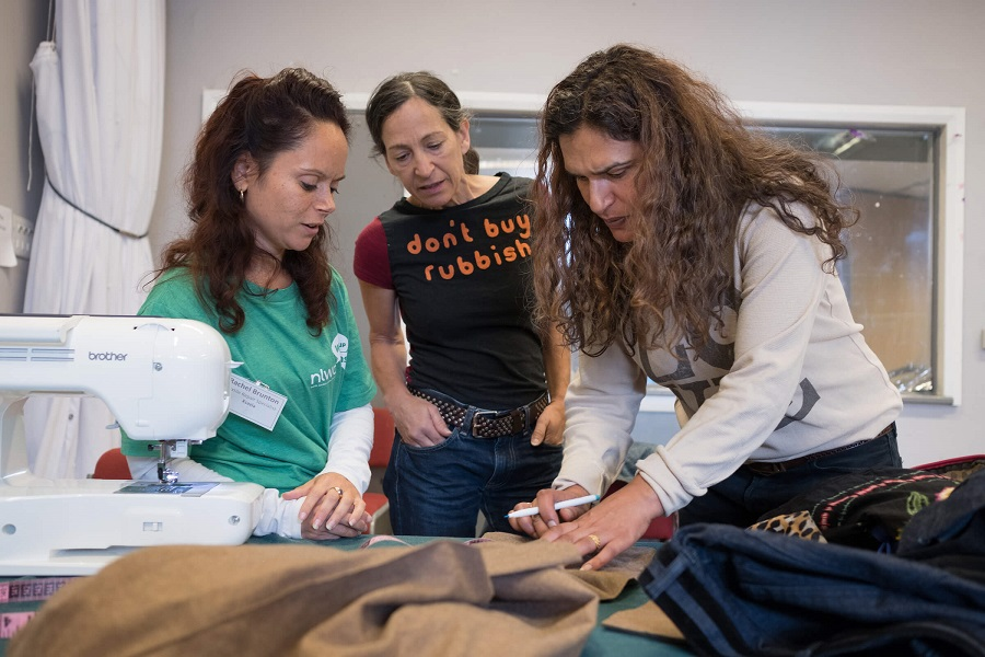 Local residents Kate Cullinan and Kiren Lee with Rachel Brunton, Textile Repair Specialist, NLWA Repair Cafe, Queen's Crescent Community Centre, Camden.