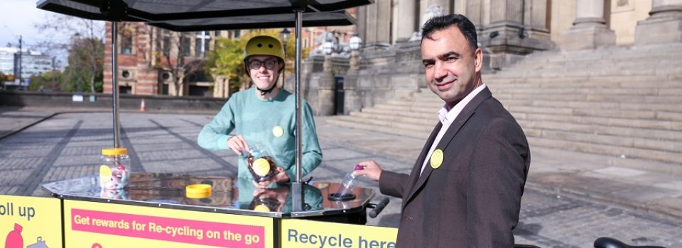 Campaigners using recycling bins