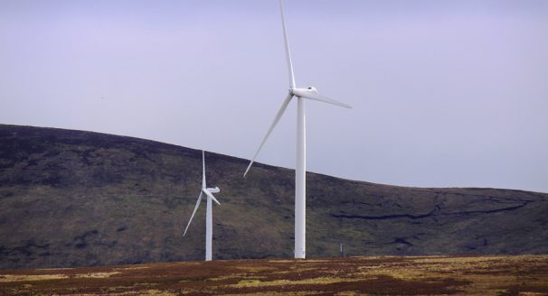 Wind turbines in remote part of Sutherland, Scotland, Europe. A wind turbine is a rotating machine which converts the kinetic energy in wind into mechanical energy. The mechanical energy is then converted to electricity