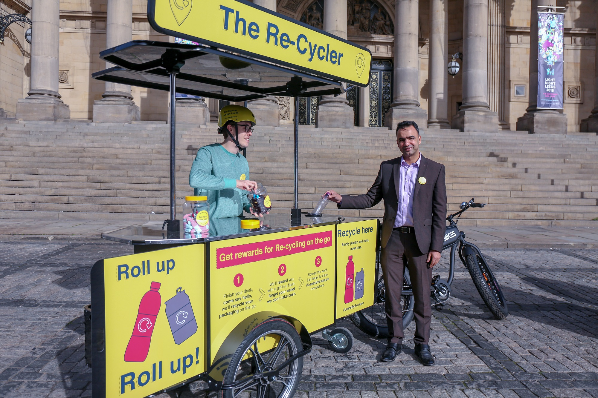 A picture of Councillor Mohammed Rafique recycling in Leeds city centre.