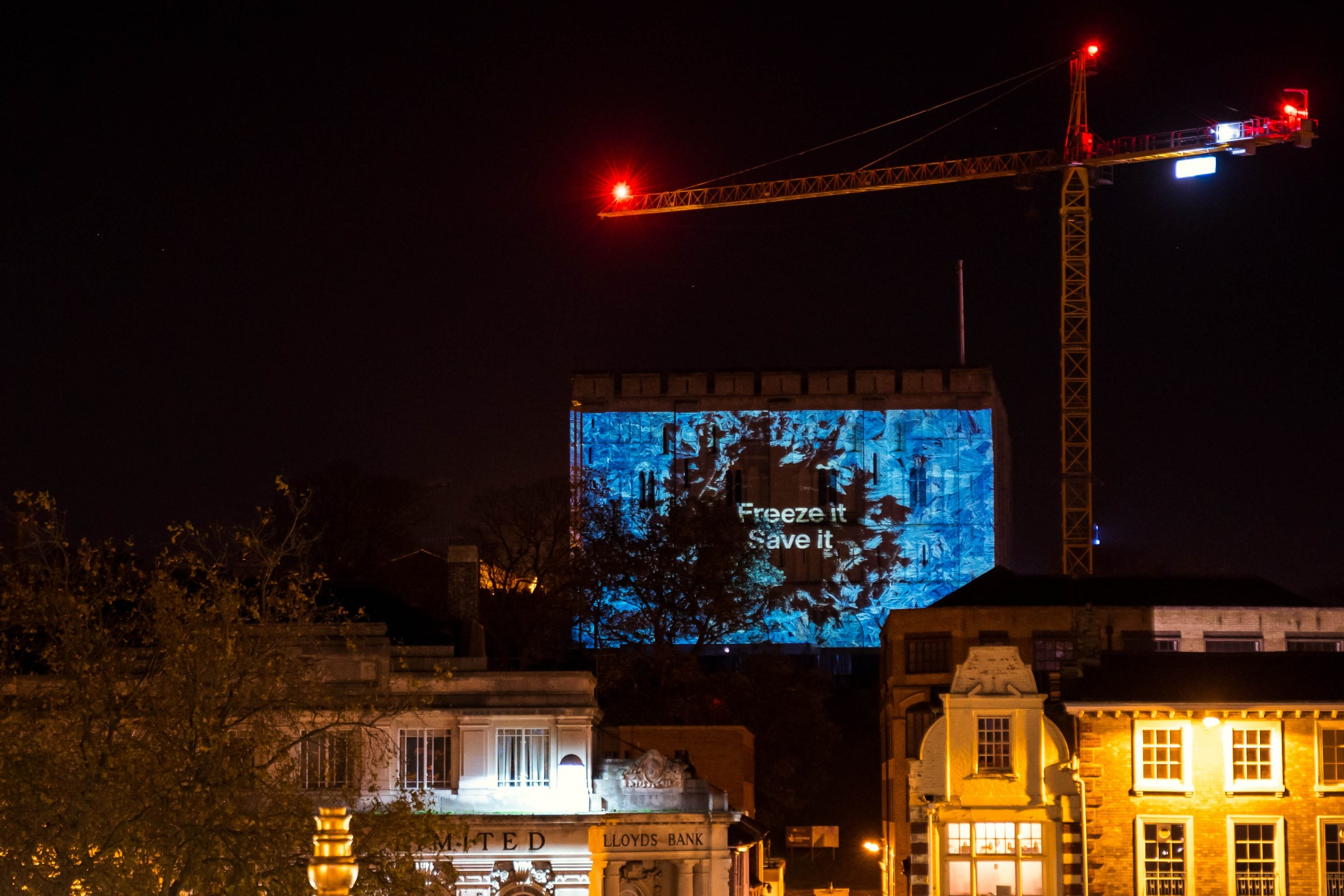 Norwich Castle glows white to highlight 6.7 million pints of milk poured down drains.