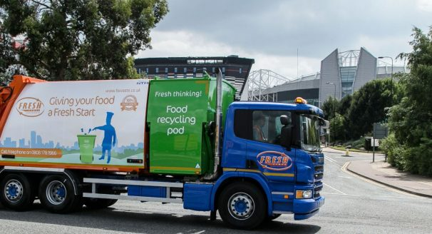 A recycling truck rests outside the Old Trafford football ground.
