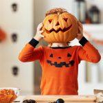 A child becomes a pumpkin monster at halloween